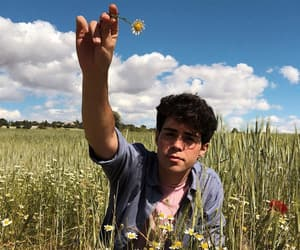 boy, clouds, and flower image