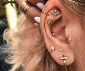 ear, piercing, and tendrils image