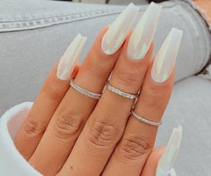 nails, rings, and holographic image