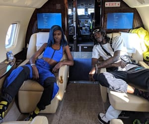 couple, model, and private jet image