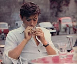 Alain Delon, boy, and cigarette image