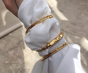 white, gold, and accessories image