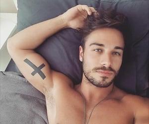 hot guy in bed image