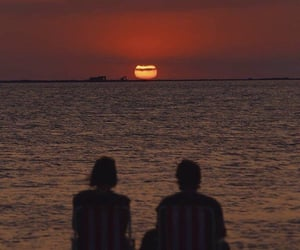 couple, sunset, and beach image