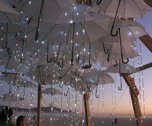 lights, beach, and umbrella image
