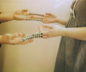 hands, girl, and chinese finger traps image
