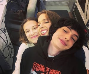 finn wolfhard, millie bobby brown, and stranger things image