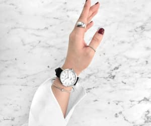 clock, hands, and nials image