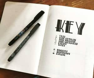 key, bullet journal, and signifier image