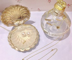 pearls, gold, and perfume image