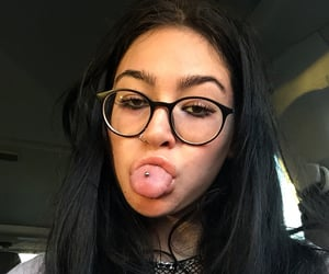 black hair, tongue piercing, and girl image