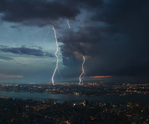 city, sky, and storm image