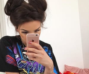 buns, necklace, and graphic tee image