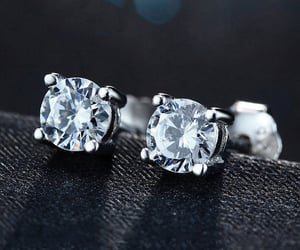stud earrings, diamond studs, and diamond stud earrings image