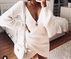 accessories, wrap dress, and plunge neckline image