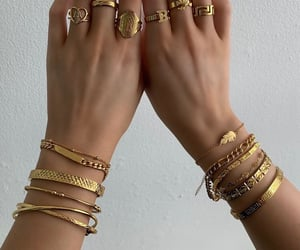 girl, gold, and rings image