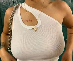 jewelry, tank top, and outfit image