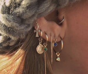 ear, jewelry, and normal image