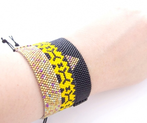 fashion, beaded bracelets, and yellow and black image