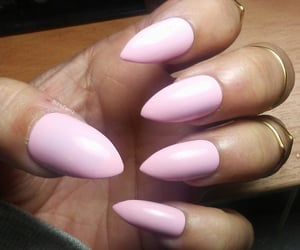 pinky, rings, and stiletto nails image