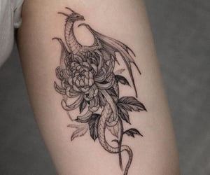 black, dragon, and flowers image