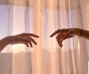 hands and morning light image