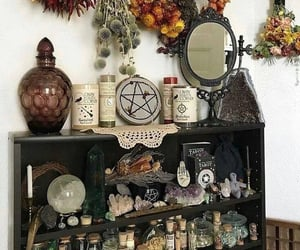altar, dried flowers, and crystal ball image
