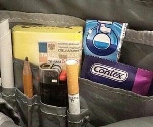 cigarette, condom, and orbit image