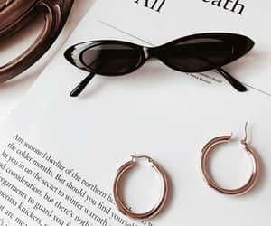 book, glasses, and sunglasses image