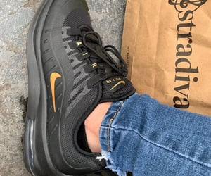 black, gold, and nike image