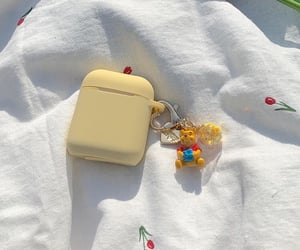 winnie the pooh and airpods case image