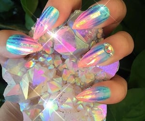 nails, crystal, and holographic image