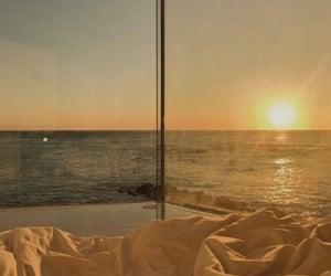 ocean, sunset, and sun image