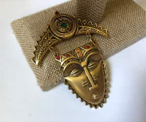 African, aztec, and brass image