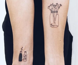 black, bottle, and flowers image
