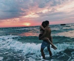 couple, kiss, and sea image