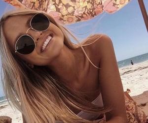 beach, sunbathing, and sunglasses image