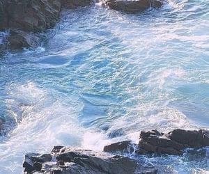 rocks, waves, and sea image