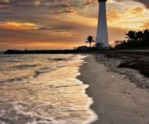beach, lighthouse, and clouds image