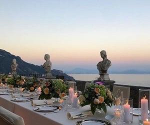 Amalfi coast, candles, and flowers image