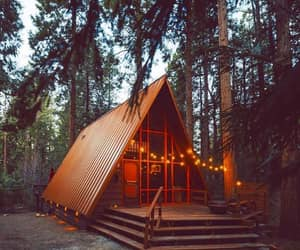 cabin, forest, and mountains image