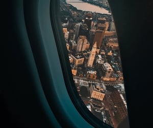 airplane and city image