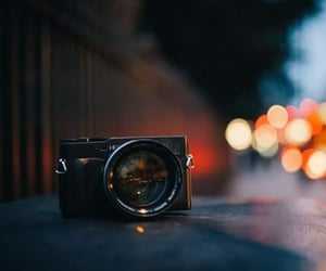 camera, lights, and city image