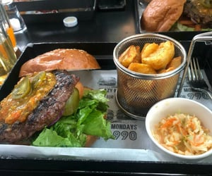 burgers, potato wedges, and chilli image