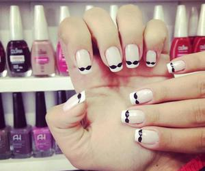nails and mustache image