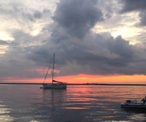 clouds, sea, and glare image