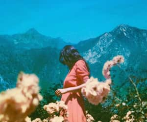 girl, flowers, and landscape image