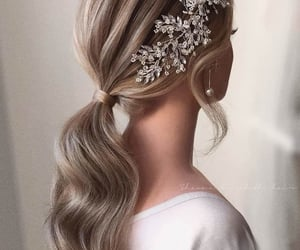 crown, hairstyle, and earrings image