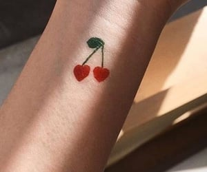 arm, cherries, and red image