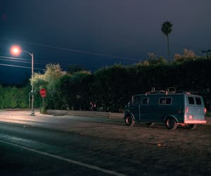 car, night, and palm trees image